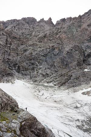Climber beneath the Donne Face of Karetai Peak, Darran Mountains, Fiordland National Park
