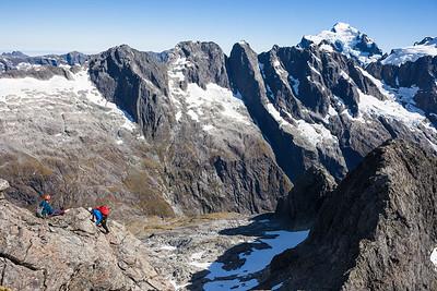 Rock climbers on Te Wera, above Cleft Creek, Darran Mountains, Fiordland National Park