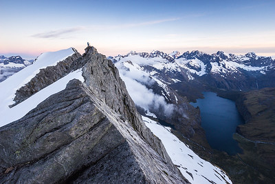 Photographer on ridge above Lake Adelaide and Moraine Creek, Darran Mountains, Fiordland National Park