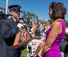 COLORADO SPRINGS - Fitchburg firefighter Patrick Haverty presents a memorial flag to Debbie Jeffries, sister of Jack Mulchay, during the Fallen Firefighters Memorial Ceremoney in Colorado Springs.  Saturday September 15, 2018 [Photo/Jim Marabello]