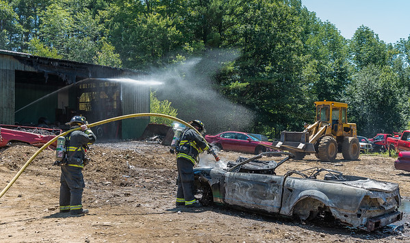 GARDNER - Gardner firefighters operate at Lajoie's Used Auto Parts, 27 Hill St. after an auto caught fire inside.