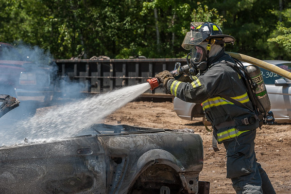 GARDNER - A Gardner firefighter attacks a car fire at Lajoie's Used Auto Parts, 27 Hill St. Monday July 9, 2018