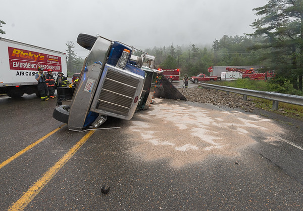 WESTMINSTER - A tractor trailer dump truck carrying a load of rock rolled over at the corner of Depot Rd and Village Inn Rd. The driver suffered minor injuries but the truck leaked approximately 20 gallons of diesel fuel and hydraulic fluid. Monday August 13, 2018 [Photo/Jim Marabello]