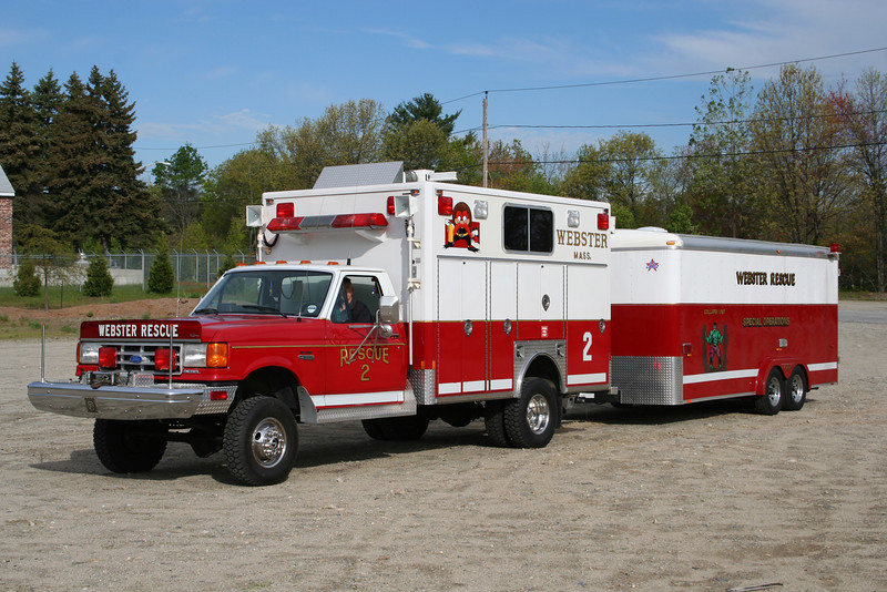 Webster Mass Rescue 2 - 1990 Ford F-550 4x4 / Frontline Medium Rescue pulling collapse rescue & special operations trailer.