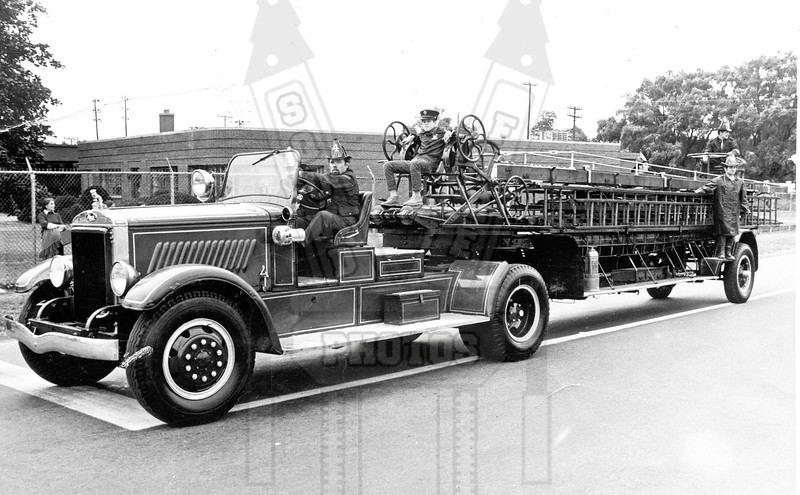 Former Hartford, Ct Ladder Co. 5 in the Connecticut State Firemens Parade in 1972. I am the kid sitting on the turntable. This truck was privately owned at the time by the driver, former Hartford, Ct Lt. Jack Jansen. Photo was taken by Ed Lescoe.