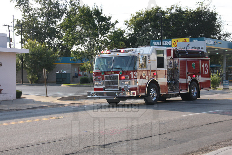 Columbia, SC Engine 13 responding past Ladder 7's quarters to a brush fire.