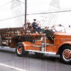 Former Hartford, Ct Ladder Co. 5 in the Connecticut State Firemens Parade in 1972. I am the kid sitting on the turntable. This truck was privately owned at the time by the driver, former Hartford, Ct Lt. Jack Jansen. Unknown photographer.