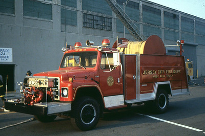 """Hose Reel - 1980 Saulsbury/International S - 2400' of 5"""" hose and a 1000 gpm front mont poump"""