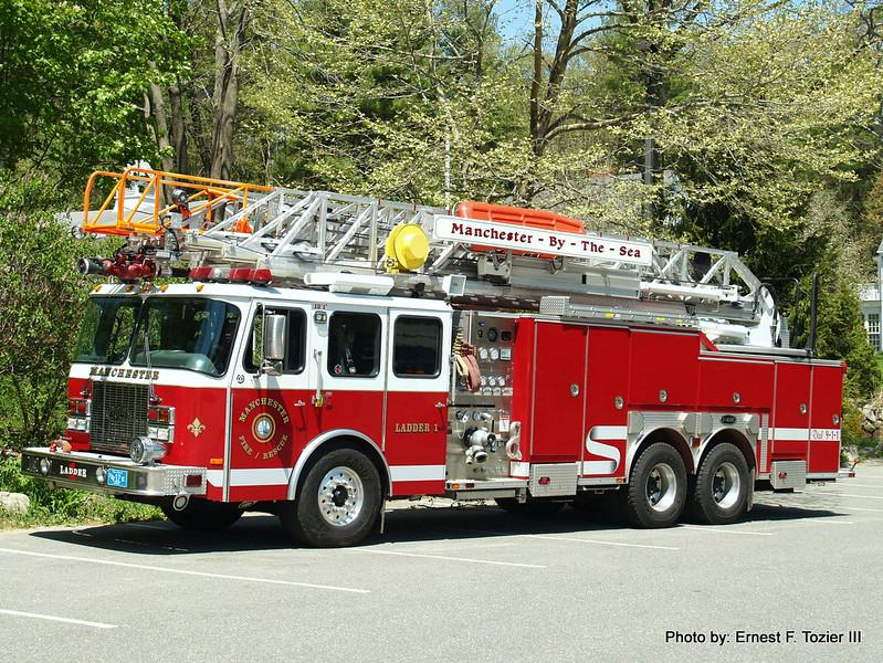 Ladder 1 - 2002 E-One 2000/500/100' Rearmount Quint