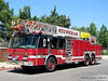 Ladder 1 - 1995 E-One Hurricane 1250/450/100' Rearmount Aerial
