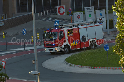 Volvo FL fire engine #16 of the fire brigade of Ghent (Gent) in Belgium. Photo taken in the late afternoon.