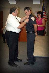 Dad pinning on Badge