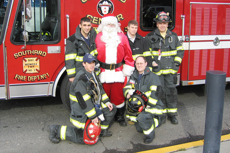 Al is on the far right in the second row.  The department delivers gifts to Children during Christmas.