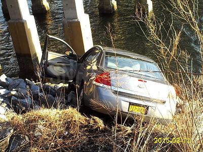(car into rocks)Loop Parkway Bridge