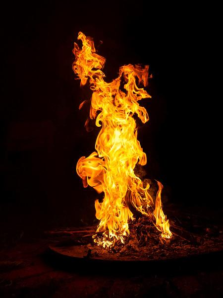 Flames; Man Doing a Handstand