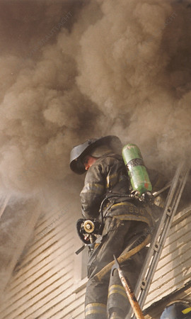 Firefighter gets ready to enter attic at this smoky blaze