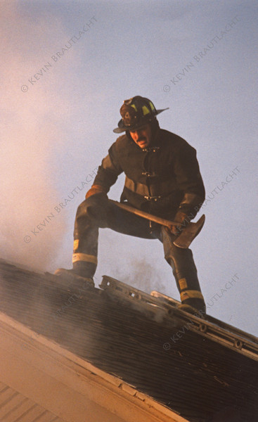 Close up of firefighter preparing to open up the roof