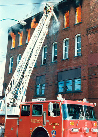 Ladder 11 working the ladder pipe.
