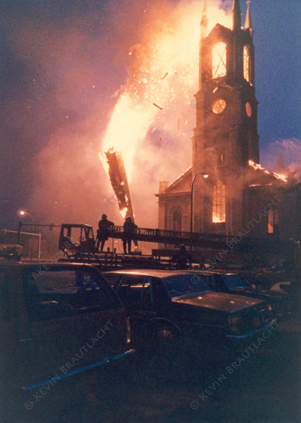 St. Mary's steeple falls to the ground at this 5 alarm fire on Broadway.  Photo by William Brautlacht