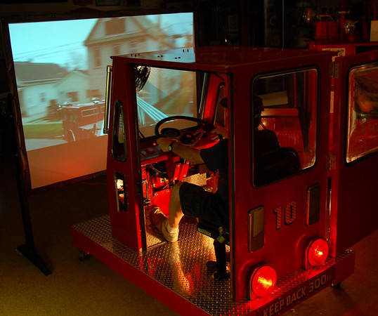 This display recreates what it feels like to drive a tiller ladder truck, using an actual tiller cab!