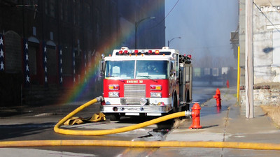 Buffalo Fire Engine 32 pumping with a rainbow in background.