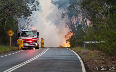 Southern edge of the fire on West Head Road, fire was burning on both sides of the road.