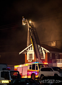 Ladder Platform 27 Parramatta at work on the Log Cabin Fire in Penrith with P98 Cranebrook supplying water The fire in March 2012 went to at least a 5th Alarm as firefighters worked to contain the blaze.
