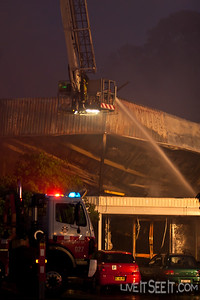Ladder Platform 27 at work with a stream into the void below the collapsed roof