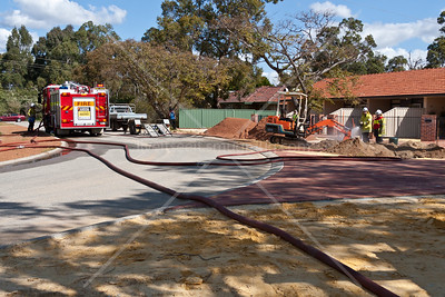 Landscapers using an excavator struck a 50mm Gas line in Kalamunda. Firefighter from Kalamunda brigade reponded and applied a water mist while Police enforced road closures awaiting the arrival of Gas workers who stopped the leak and made repairs.