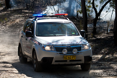 The Safety Officer in one of Gosford's Fire Investigation vehicles monitors operations.