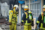 Exiting RFS firefighter liases with entering FRNSW crew
