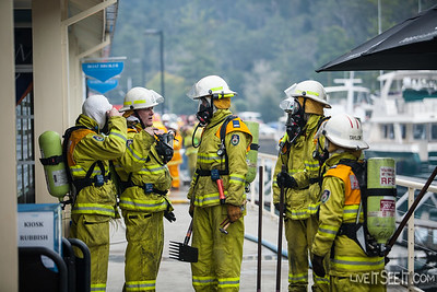 RFS crew who have exited the fire area brief incoming BA Crews