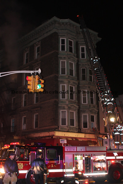 Firefighter decent a ladder during a multiple alarm mixed occupancy fire at 300 Washington St in Hoboken, NJ