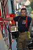 Tri-Clover Assistant Fire Chief Val Strock operates the pump of Engine 2611 during a garage fire in Weisenberg Township