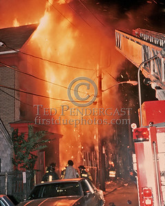 "Sat., Sept. 27,1986 - Fire Alarm reported they were ""Receiving Calls"" for a fire in the alley of a building in Andrew Square at the intersection of Dorchester Avenue & Dexter St (South Boston). Companies had chased several trash fires in the area much of the evening. As misfortune would have it, the two first-due Engines and the first-due Truck (E39, 21 & L18) were all committed to other stills at the time the box was struck. District 6 arrived by himself and found a significant fire in the alley off Dexter St opposite the Andrew Square MBTA Station. He transmitted three alarms as the fire communicated to three buildings while he waited for the first companies to arrive. Five Alarms were transmitted on Box 7234 in total for this fire.  Another shot from the same spot. Hey, there's Mike again!"