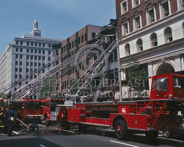 May 24,1986 - 2 Alarms Box 1534 for a building on Boylston St near Berkley. This building burned more than once. The reason for all the ladder work was due to the condition of the interior from previous fires.