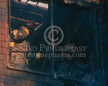Nov.1,1986 - 2 Alarms Box 3537 for a fire on the second floor of a multi-family occupied dwelling on Wildwood St (Mattapan).  Ladder 29 overhauling on the second floor porch.
