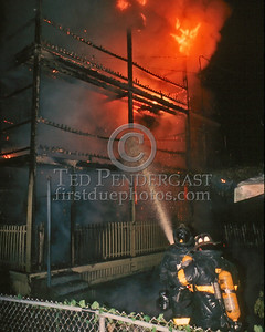 August 22,1986 - Fire involving the rear porches of a 3-Decker on Pleasant St in Dorchester. The fire was held to a Working Fire
