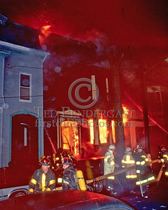 **LODD** March 21,1986 - 9 Alarms Box 7413 (Telegraph Hill, South Boston) - Fire in a 3-story dwelling. Heavy fire condition on the first floor extended up. FireFighter Edward R. Connolly of Ladder Co. 17 was killed when the fire building collapsed into the street about 15 minutes after this photo was taken.  I believe he was acting as a Chief's Aide the night of the fire.