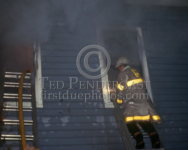 New Years Eve - Dec.31,1986 - 2 Alarms Box 5276 for a fire in an occupied two-family house on Litchfield St (Allston). Stubborn basement fire spread to all floors.  A Chief checks with the crews on the Second Floor.