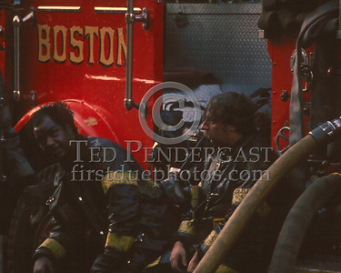 Nov.1,1986 - 2 Alarms Box 3537 for a fire on the second floor of a multi-family occupied dwelling on Wildwood St (Mattapan).  Firefighters taking a break