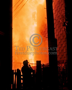 "Sat., Sept. 27,1986 - Fire Alarm reported they were ""Receiving Calls"" for a fire in the alley of a building in Andrew Square at the intersection of Dorchester Avenue & Dexter St (South Boston). Companies had chased several trash fires in the area much of the evening. As misfortune would have it, the two first-due Engines and the first-due Truck (E39, 21 & L18) were all committed to other stills at the time the box was struck. District 6 arrived by himself and found a significant fire in the alley off Dexter St opposite the Andrew Square MBTA Station. He transmitted three alarms as the fire communicated to three buildings while he waited for the first companies to arrive. Five Alarms were transmitted on Box 7234 in total for this fire.  Right about this time he was ordering the 2nd Alarm..."