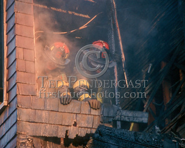 Nov.1,1986 - 2 Alarms Box 3537 for a fire on the second floor of a multi-family occupied dwelling on Wildwood St (Mattapan).  Ladder 6 using a little muscle to get the job done.