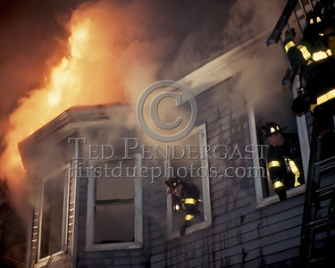 New Years Eve - Dec.31,1986 - 2 Alarms Box 5276 for a fire in an occupied two-family house on Litchfield St (Allston). Stubborn basement fire spread to all floors.