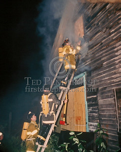 SAUGUS, Mass. - August 27,1986 - Firefighters operating at a Working Fire in a barn on Vine Street.