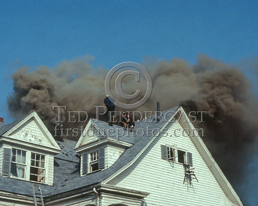WINCHESTER, Mass. - July 7,1986 - 4 Alarms struck for this fire in a large single-family home on Wedgemere Avenue. The fire started in the basement and spread via the walls to the attic. - Here Winchester firefighters remain on the roof after ventilating, apparently cut off from their primary means of eggress.