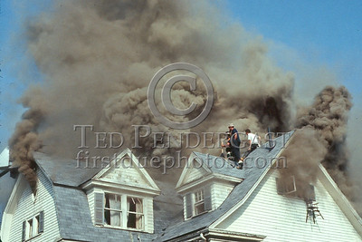 WINCHESTER, Mass. - July 7,1986 - 4 Alarms struck for this fire in a large single-family home on Wedgemere Avenue. The fire started in the basement and spread via the walls to the attic. - Conditions are particularly precarious at this point.