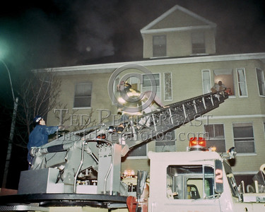 SOMERVILLE, Mass. - Dec.6,1986 - 4 Alarms transmitted for this fire at 202 Highland Avenue. Ladder 2 removing the two occupants we missed during our initial search over the stick.