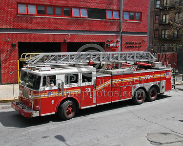 FDNY Ladder Co.30, operating with a spare truck - 111 West 133rd Street, Harlem (Manhattan), NYC