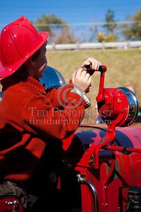 Future Firefighter cranking the Sterling Siren Fire Horn